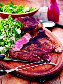 Grilled rib eyes with watercress, blue cheese and radish salad