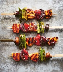 Grilled vegetable skewers with harissa-marinated halloumi