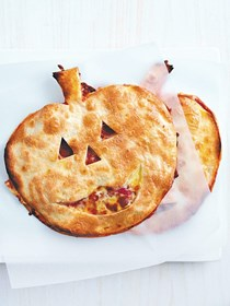 Halloween pumpkin head pizzas
