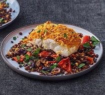 Harissa-crumbed fish with lentils & peppers