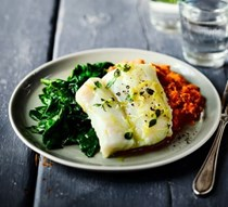 Herb & garlic baked cod with romesco sauce & spinach