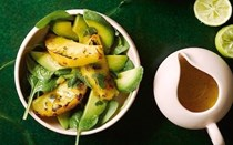 Hot pineapple, avocado and spinach salad with ginger dressing