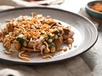 Indian street snack with potato, chickpeas, and chutneys (Papri chaat)