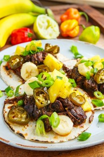 Jamaican jerk beef taco with pineapple and banana salsa