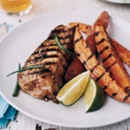 Jerk halibut steaks with sweet potato wedges