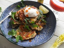 Jerk spiced corn fritters with sour cream and hot sauce