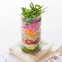 Layered spring salad with tangerines, quinoa, and pistachios
