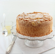 Lemon almond sponge cake with warm lemon sauce