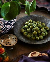 Marinated green harissa olives