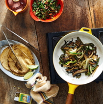 Mushroom fajitas with arugula-pecan salsa and queso fresco