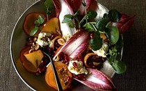 New Year's Eve dinner: persimmon, pomegranate and red chicory salad with goat's cheese and toasted hazelnuts