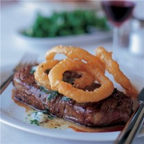 New York steak with beer-battered onion rings