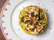 Open-faced ka'ak sandwich with avocado, za'atar, and halloumi