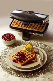 Orange waffles with burst of cranberry topping