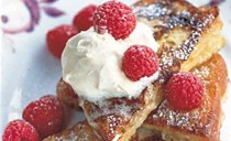 Pain perdu with clotted cream and raspberries
