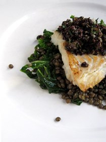 Pan-fried cod with tapenade, lentils and kale
