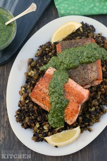 Pan-seared salmon with mixed greens pesto & lentil black rice salad