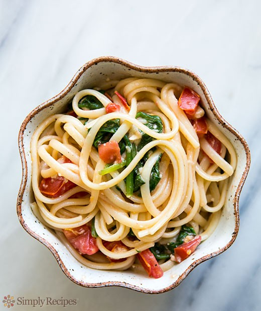 Pasta with tomato, spinach, basil, and Brie