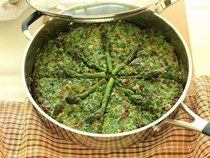 Persian-style asparagus frittata with fresh herbs, walnuts and barberries (Kookoo-ye marchoobeh)