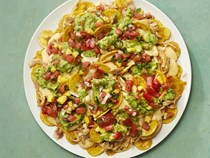 Plantain chip nachos with spicy chicken
