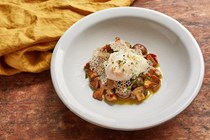 Poached egg with mushrooms a la Grecque and olive oil crisps