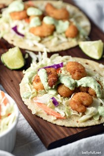 Popcorn shrimp tacos with cilantro lime sauce