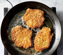 Potato-crusted pork schnitzel with hot pepper mayonnaise