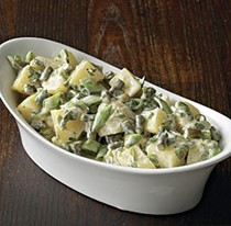 Potato salad with garlic scapes, snap peas, and scallions