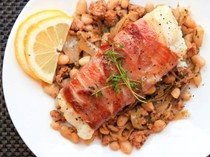 Prosciutto-wrapped cod with chorizo and cannellini beans