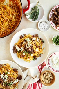 Pumpkin pasta dinner with sausage and goat cheese
