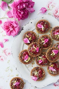 Raspberry and rose tartlets with pistachio frangipane