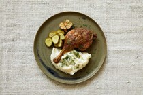 Roast duck legs with soured cream and mashed potato