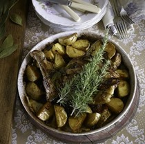 Roast lamb and potatoes with wild fennel and semi-dried tomatoes