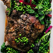 Roast shoulder of lamb with summer greens