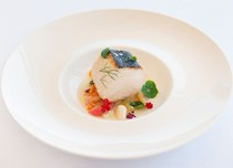 Roasted amberjack with cooked vegetable salad, almonds and tomato water