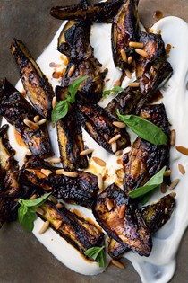 Roasted aubergine with black garlic, pine nuts and basil