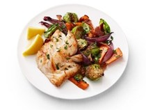 Roasted cod with carrots and Brussels sprouts