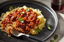 Roasted spaghetti squash with tempeh Bolognese