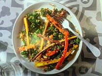 Roasted spiced carrots with quinoa, green ribbons, and turmeric vinaigrette
