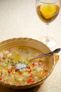 Roasted white corn chowder with garlic and herb butter