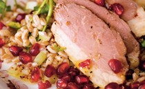 Salad of smoked duck with farro, red chicory, and pomegranates