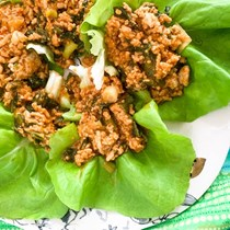 Sambal oelek chicken lettuce wraps with radish greens and spring onion
