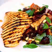 Seared salmon with radicchio, pancetta, pinenuts and balsamic vinegar