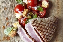 Seared tuna fillet, cherry tomatoes, capers, red onion, basil, croutons