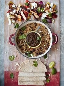 Sizzling chicken fajitas, grilled peppers, salsa, rice & beans