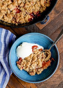 Skillet peach crisp with ginger and pecans