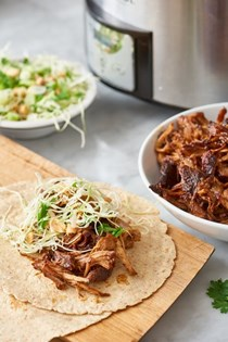 Slow-cooked hoisin and ginger pork wraps with peanut slaw