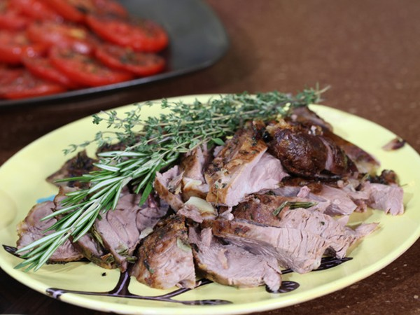 Slow-roasted parchment-wrapped leg of lamb with garlic & herbs