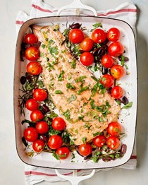 Slow-roasted salmon with garlicky tomatoes, olives, and herbs