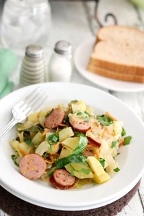 Smoked sausage with braised cabbage and potatoes
